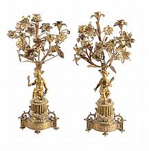 A pair of French gilt metal five light candelabra in Louis XV taste