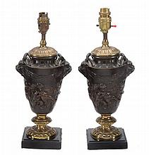 After Claude Michel, called Clodion , a pair of patinated and parcel gilt...