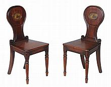 A pair of Regency mahogany hall chairs, circa 1815