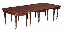 A George III mahogany extending dining table , circa 1810