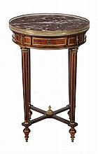 A French mahogany and marble mounted circular occasional table