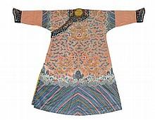 A rare embroidered Imperial apricot ground twelve symbols dragon robe, jifu