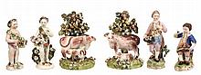 A pair of Derby porcelain cow and calf bocage groups, circa 1820