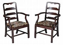 A pair of mahogany armchairs in George II style, late 19th/early 20th century