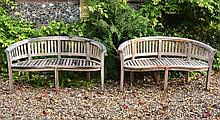 A pair of teak garden benches, of recent manufacture