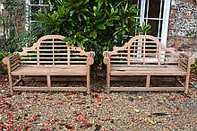 A pair of teak garden seats in the manner of Lutyens, of recent manufacture