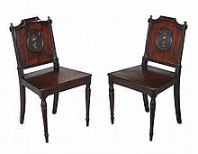 A pair of Regency mahogany hall chairs , circa 1815