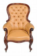 A Victorian mahogany and leather upholstered library chair , circa 1860