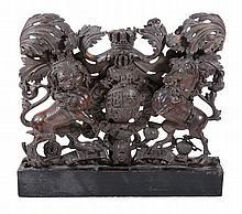 A George II /early George III sculpted walnut armorial panel