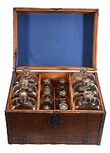 A Low Countries oak and iron-bound travelling set of glass spirit decanters