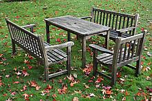 A composed set of teak garden dining furniture, last quarter 20th century