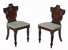 A pair of mahogany hall chairs, circa 1835 and later
