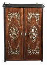An Anglo-Indian rosewood and mother of pearl inlaid cupboard , mid 19th century