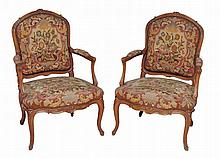 A pair of needlework upholstered armchairs in Louis XVI style