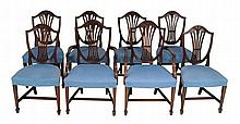 A set of eight mahogany and upholstered dining chairs in George III style