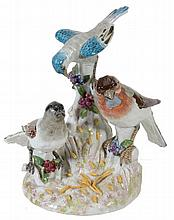 A Continental porcelain group of three birds on a stump, late 19th century