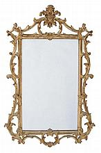 A giltwood fretwork mirror in the manner of Chippendale