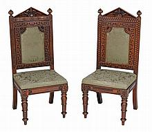 A near pair of early Victorian carved oak and upholstered side chairs