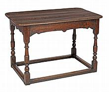 An oak centre table , late 17th century, the plank top with rounded corners...