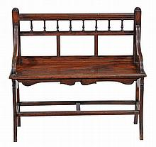 A Victorian mahogany hall bench, circa 1890, in the Shoolbred manner
