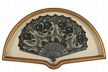 A large mother-of-pearl mounted lace fan, 19th century