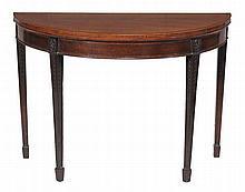 A late George III mahogany semi-elliptical folding card table, circa 1800