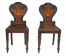 A pair of early Victorian oak hall chairs, circa 1840