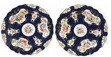 A pair of Royal Worcester blue-scale-ground plates signed by E