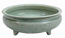 A Longquan celadon censer, Ming dynasty, of typical circular form raised on...