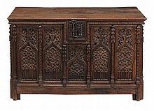A Gothic oak coffer, 16th century and later, with a rectangular plank top