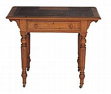 A Victorian oak writing table , circa 1870, in the manner of Gillows
