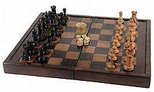 A mahogany, sycamore and walnut folding games board, 19th century