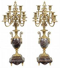A pair of Continental gilt metal mounted marble six light candelabra, late 19th century