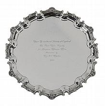 The Fair Mile Trophy, a silver shaped circular salver by C. J