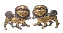 A pair of gilt copper repoussé Buddhistic lion panels, possibly Tibetan