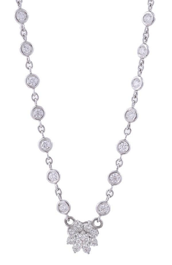 A diamond set necklace, the spectacle set