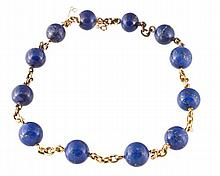 A French lapis lazuli and gold necklace, set with