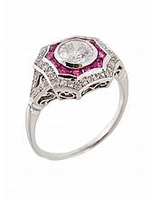 A ruby and diamond dress ring, the central