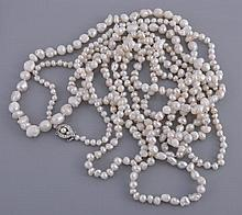 A baroque natural pearl rope necklace, the