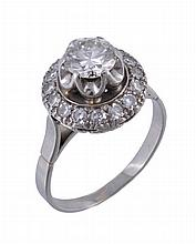 A diamond cluster ring, the principal brilliant