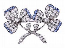 A diamond and sapphire clover brooch, circa 1890,