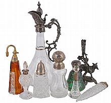 A collection of cut glass bottles with silver and electro-plated mounts