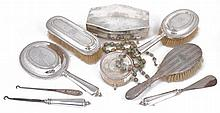 A collection of silver dressing table items, including