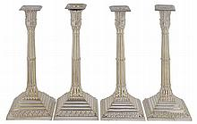 A set of four electro-plated cluster column candlesticks by Mappin Bros