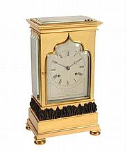 An early Victorian small gilt and patinated brass four-glass mantel clock...