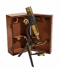 A late Victorian lacquered and patinated brass portable monocular microscope...