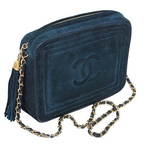 Chanel, a green suede clutch style handbag,