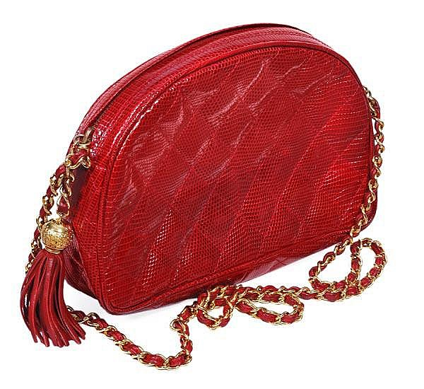 Chanel, a quilted wine red lizard clutch style
