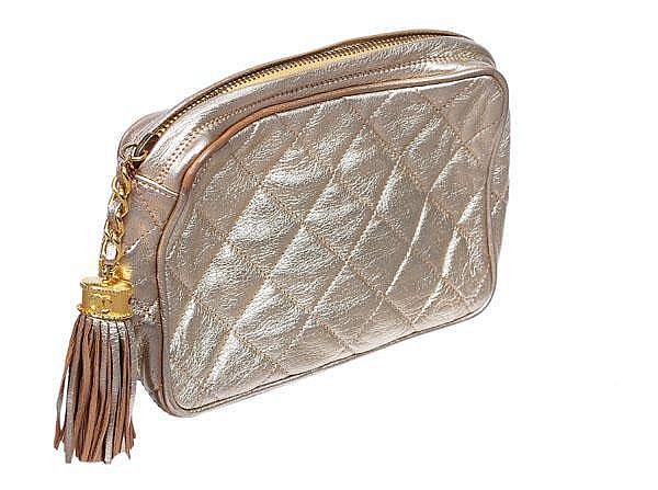 Chanel, a quilted gold metallic leather clutch