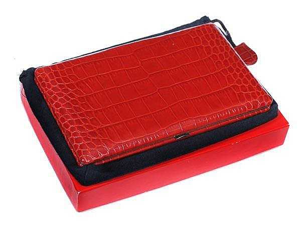 Abas, a red crocodile and chromed metal frame